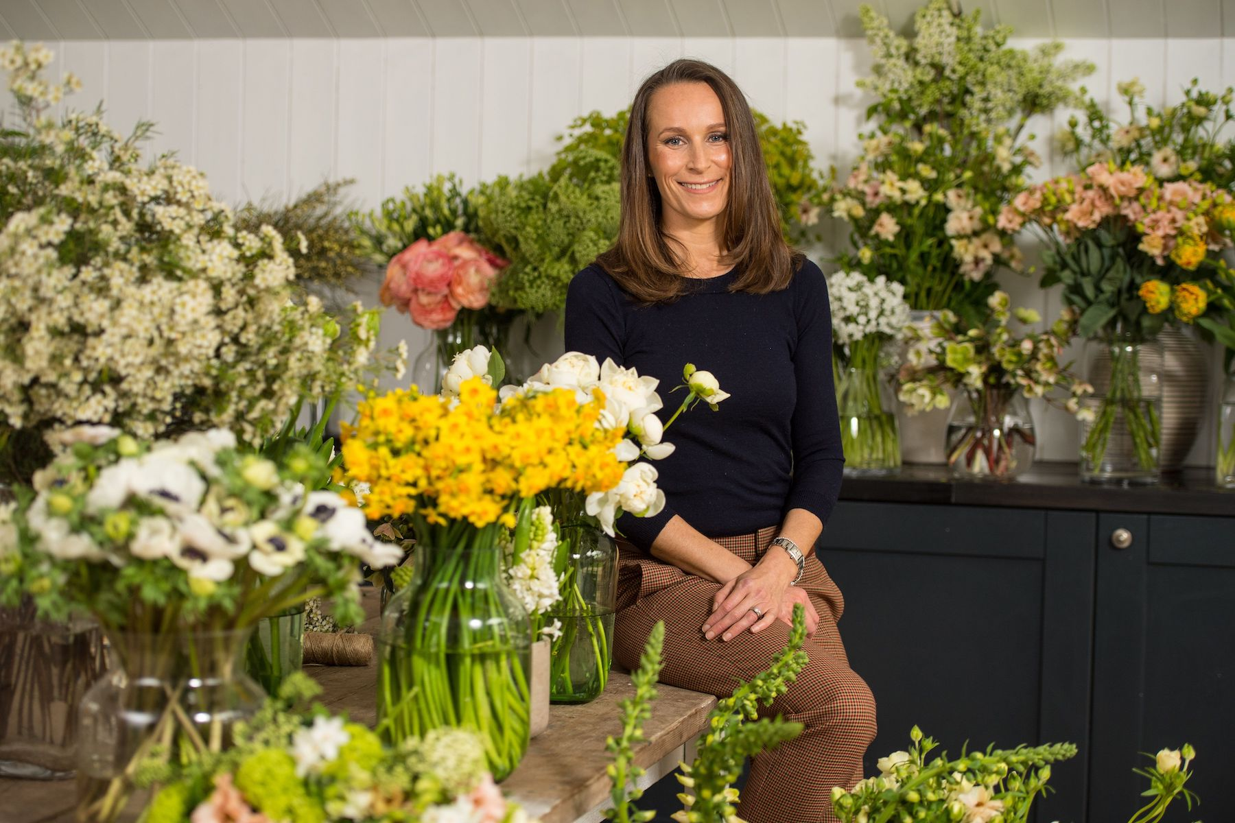 Philippa Craddock Royal Wedding Florist surrounded by flowers