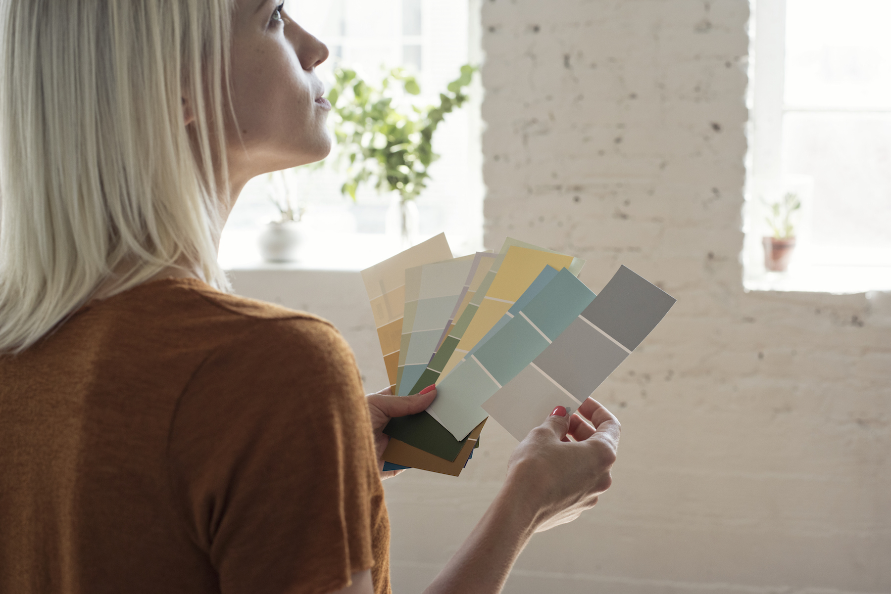 Woman Picking Paint Chips