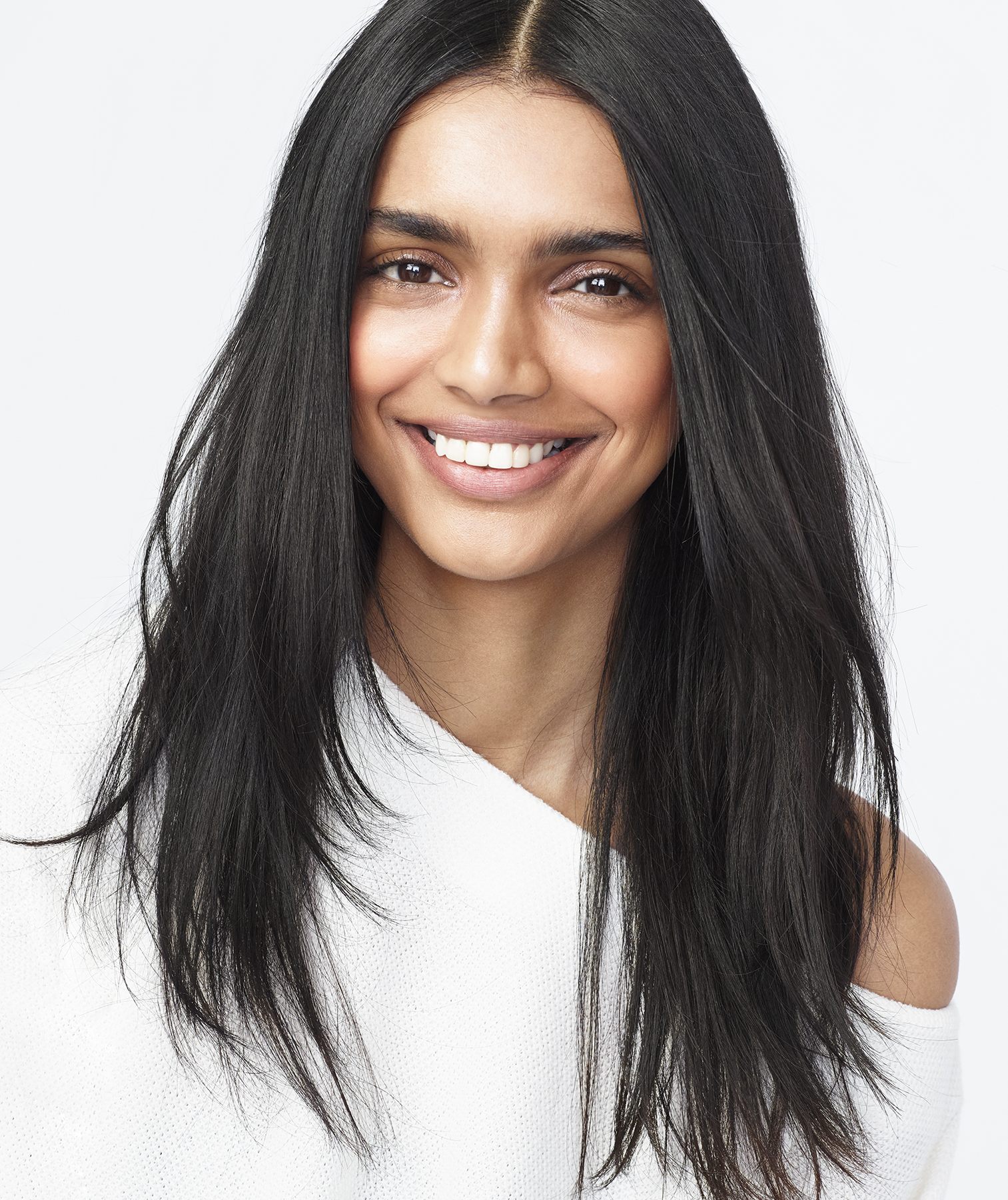 Dark-haired model with long straight hair