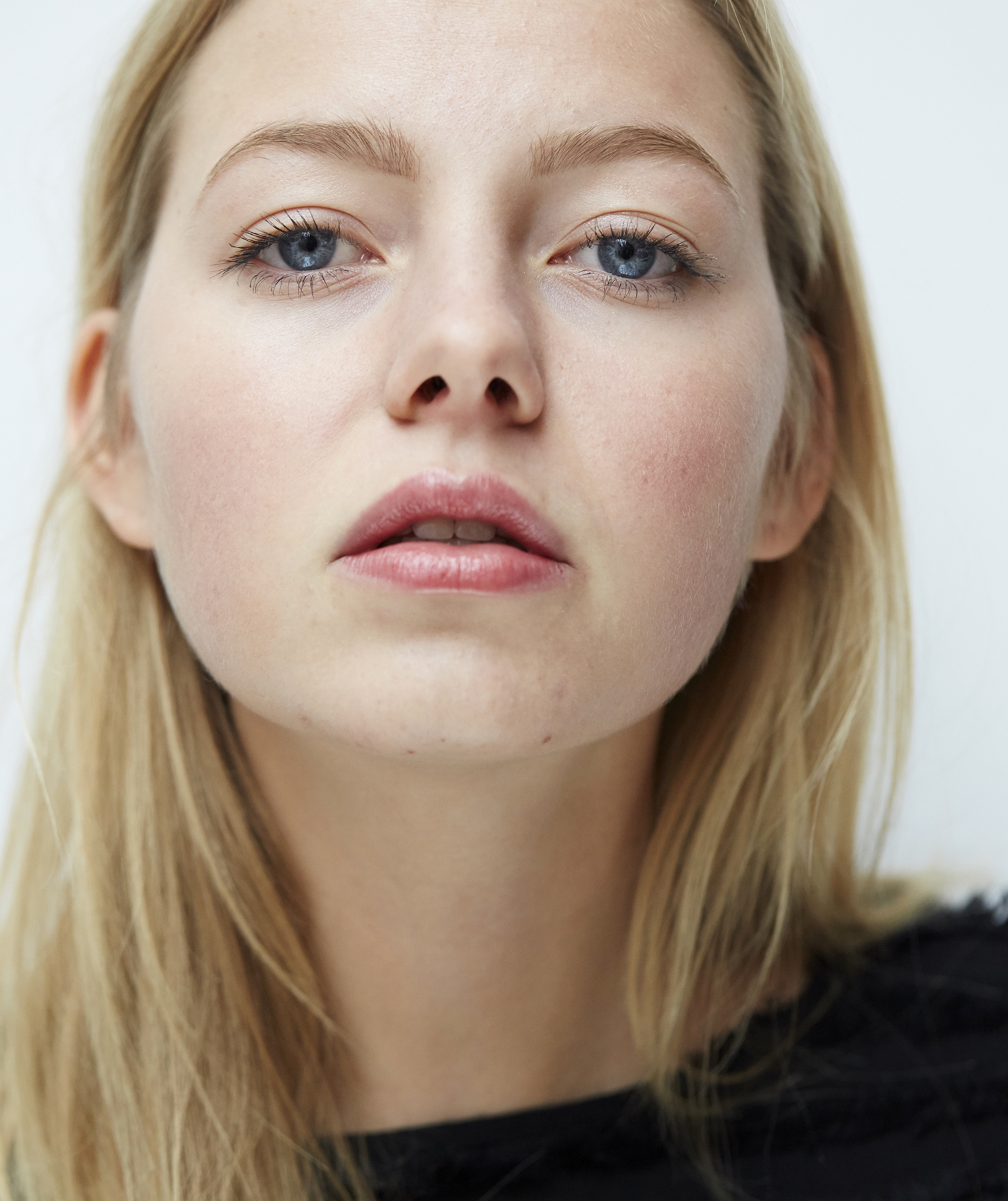 Blonde model with fair skin and blue eyes