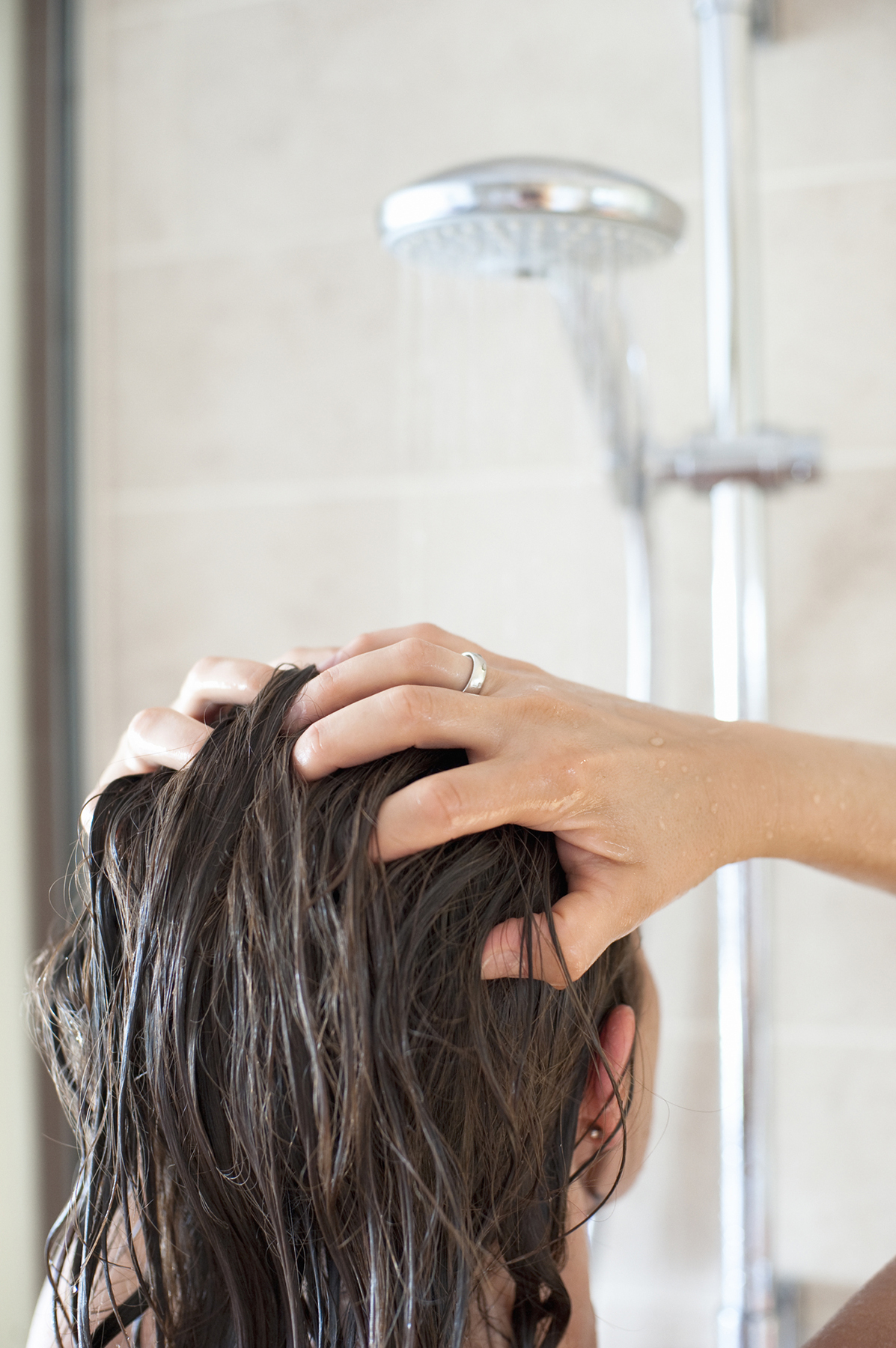 Woman Rinsing Hair in Shower
