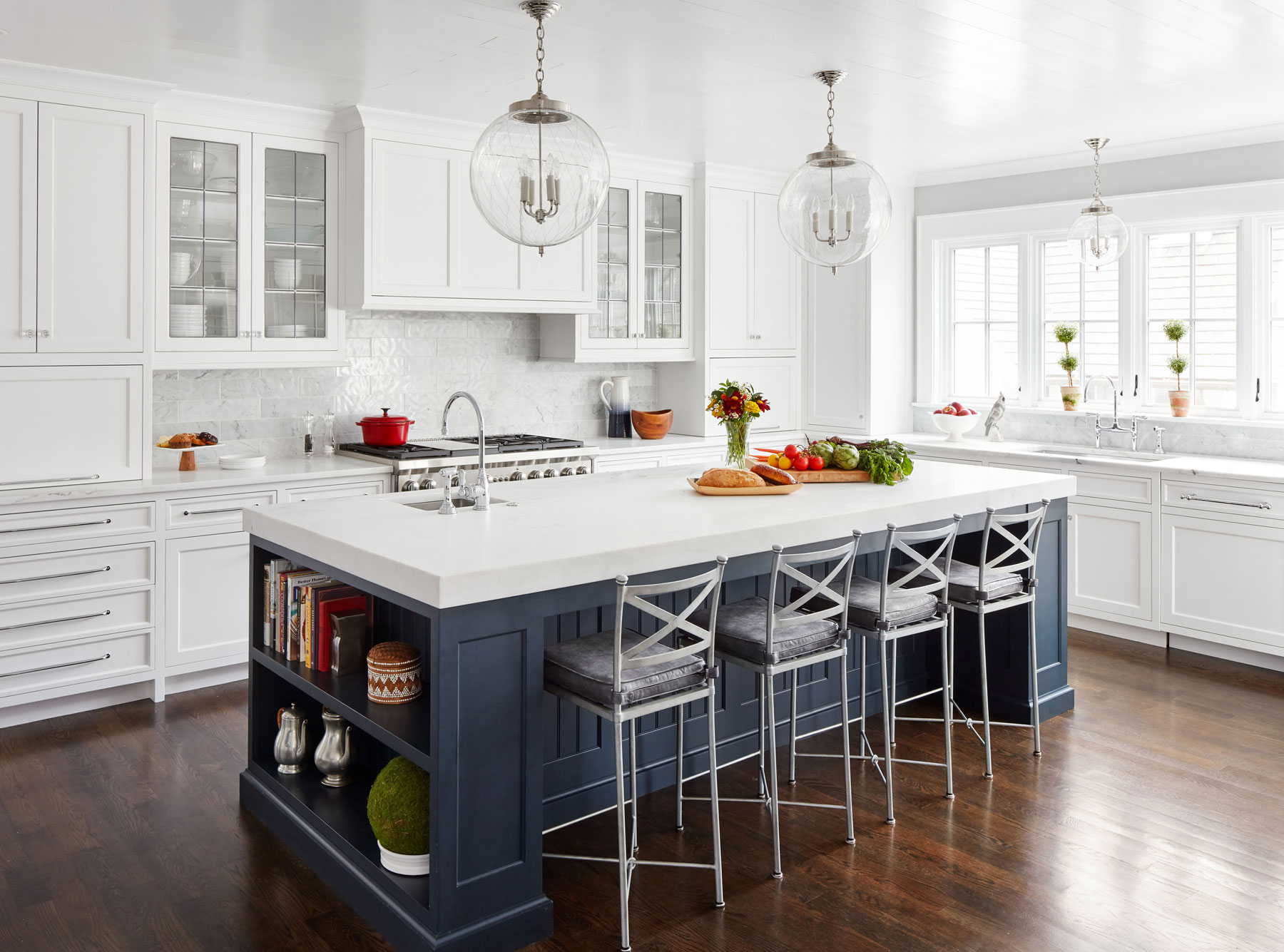 Compared to the living room and foyer, the kitchen is much calmer—though with the same impactful blue focal point.
