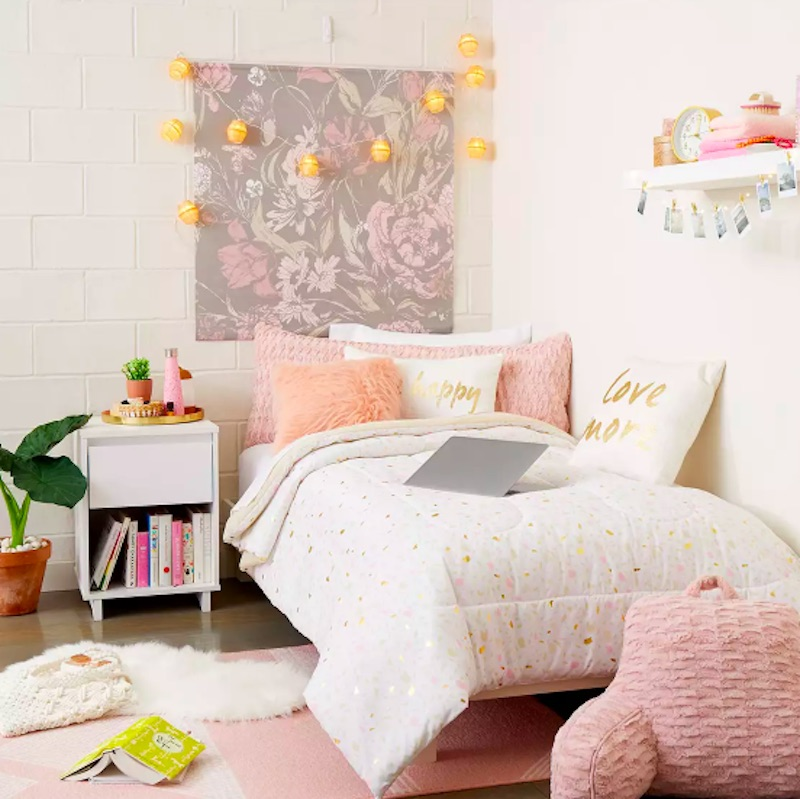 Dorm room decor, boho pink dorm room with pillows and floral wall art