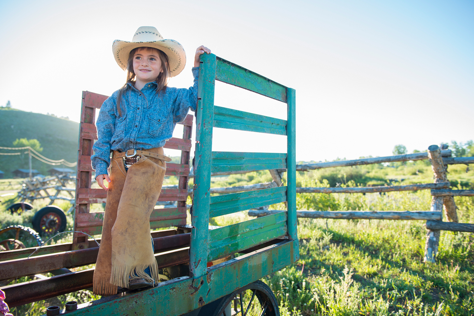Young girl on a dude ranch vacation, having a wonderful time thanks to the dude ranch vacation hacks her parents used.