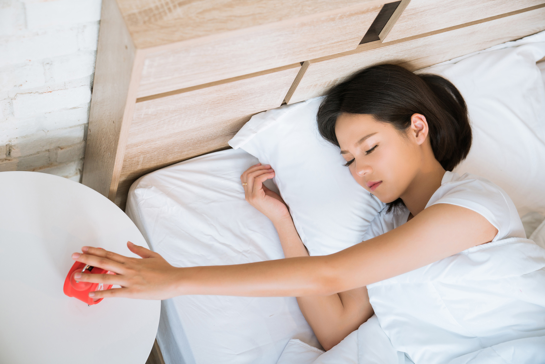 A woman who needs to learn how to stop hitting snooze in the morning.