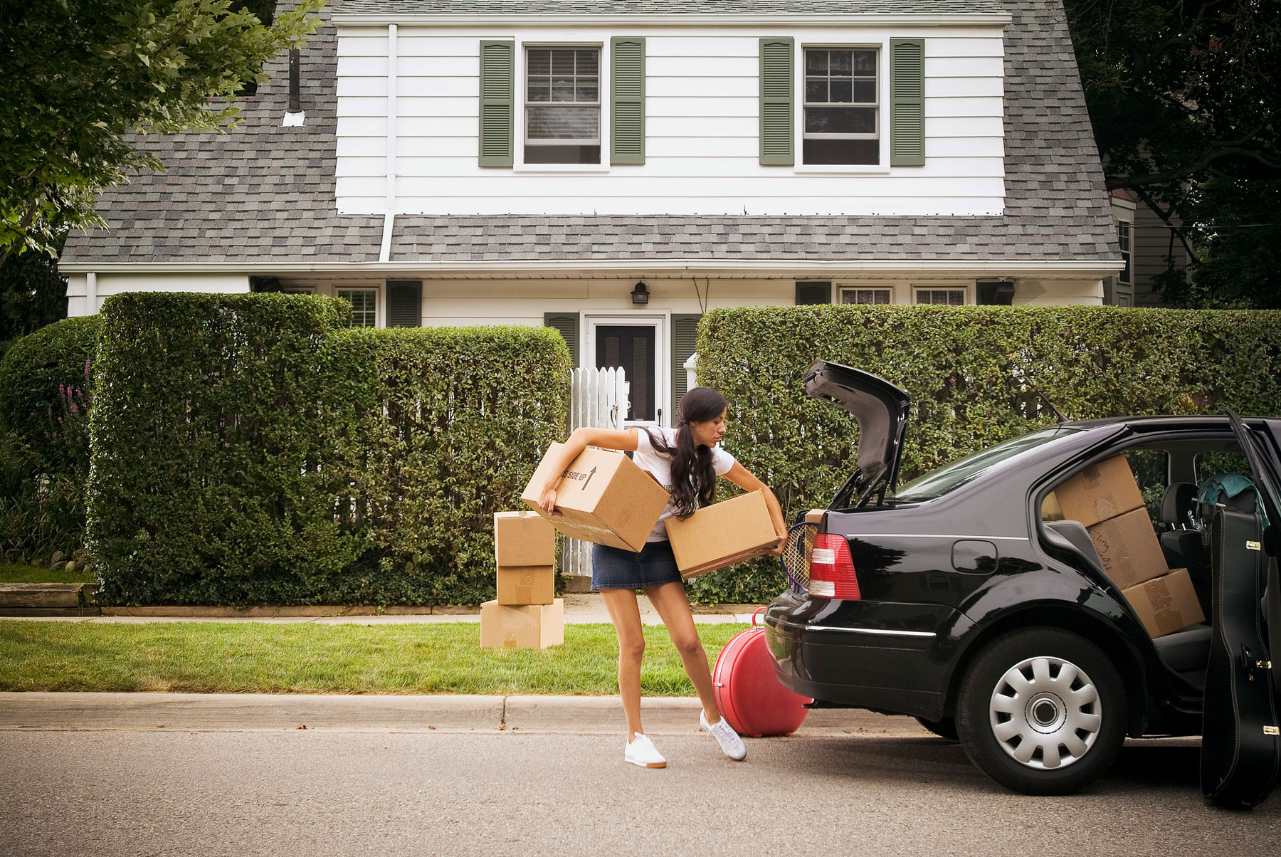 Things You Need For Your First Apartment - Woman Moving In