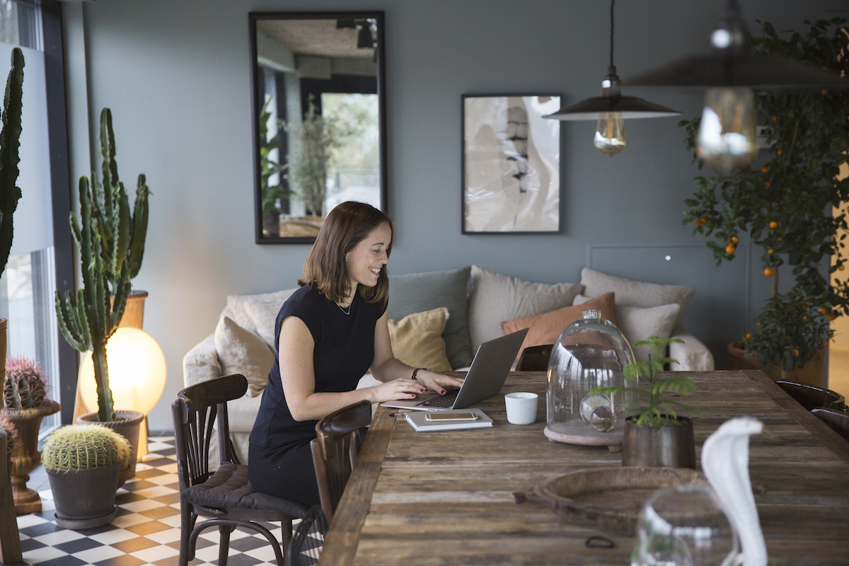 Woman in Dining Room with Plants