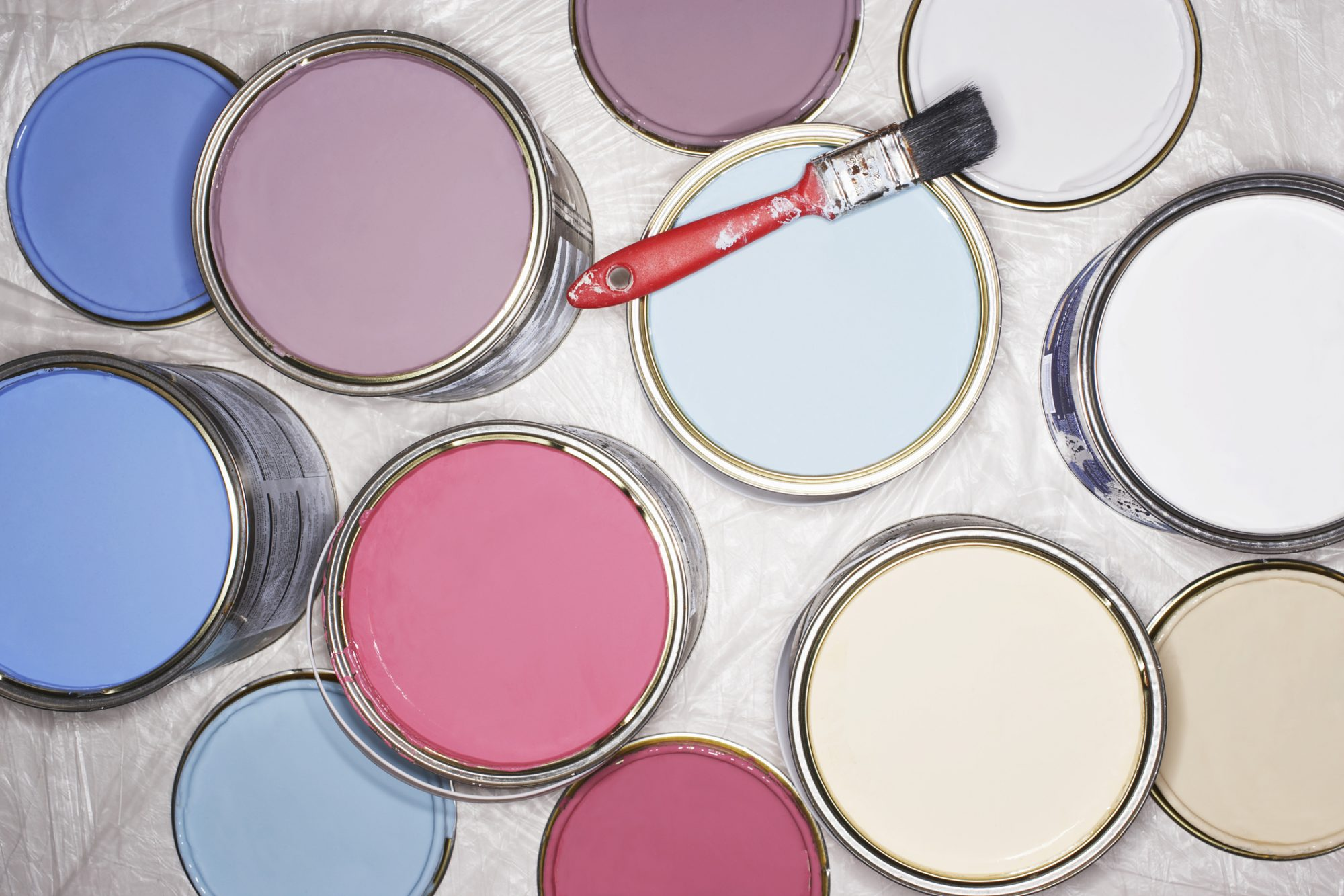 Cans of paint. Is one the Behr Color of the year?