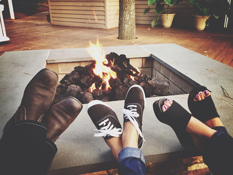 Family Relaxing By Fire Pit