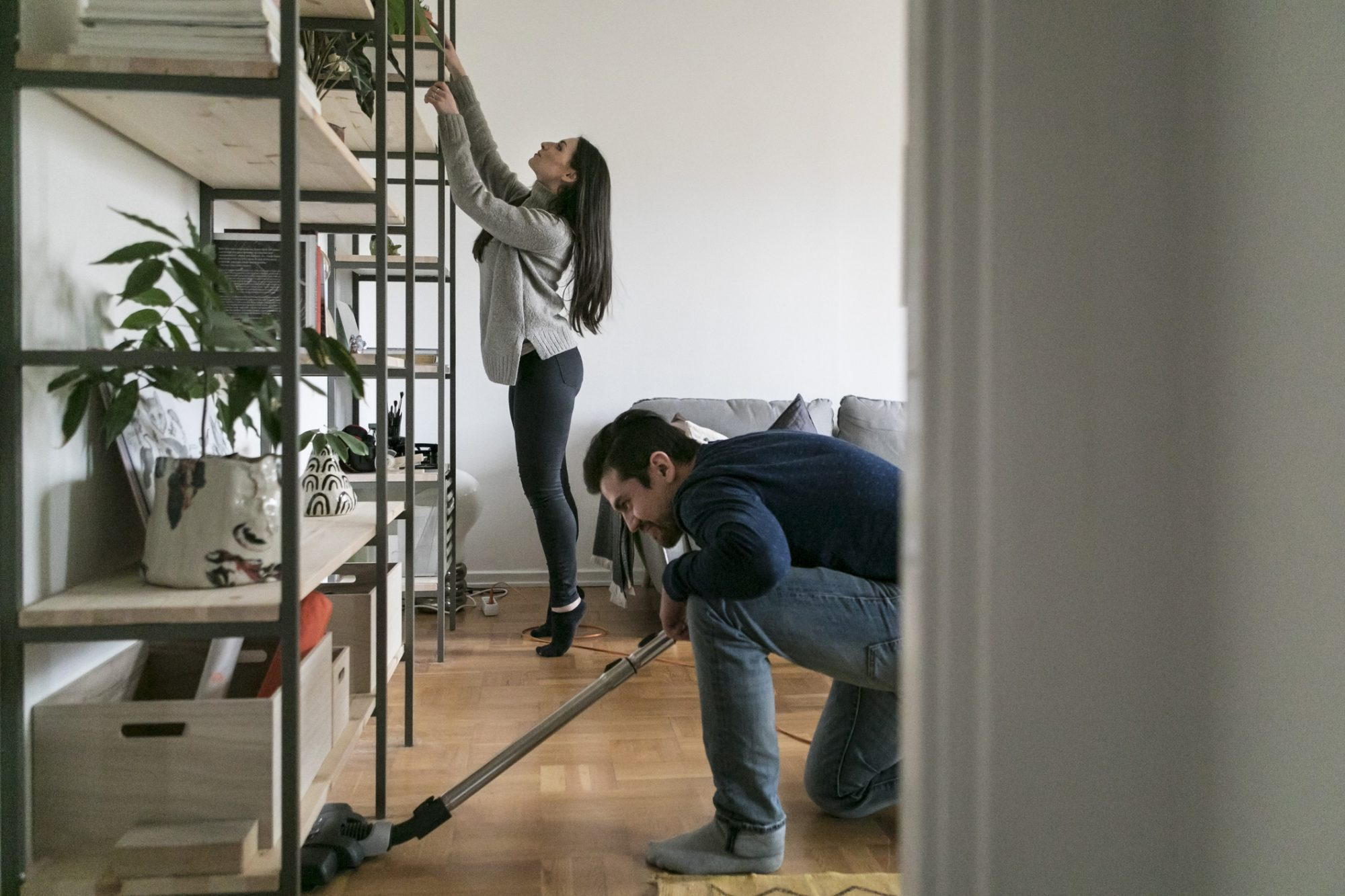 Couple using cleaning products recommended by professional cleaners.
