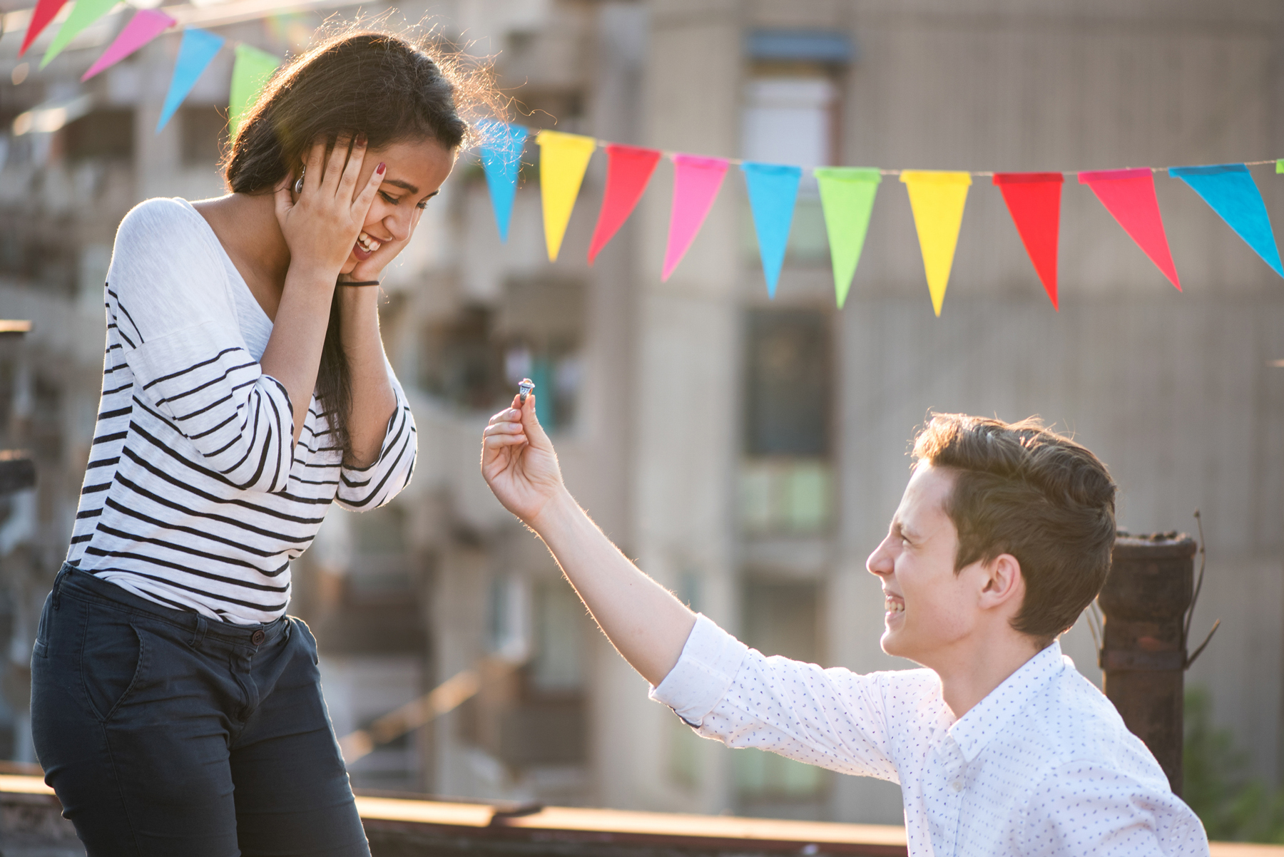 Engagement season ring trend predictions - man proposing to woman