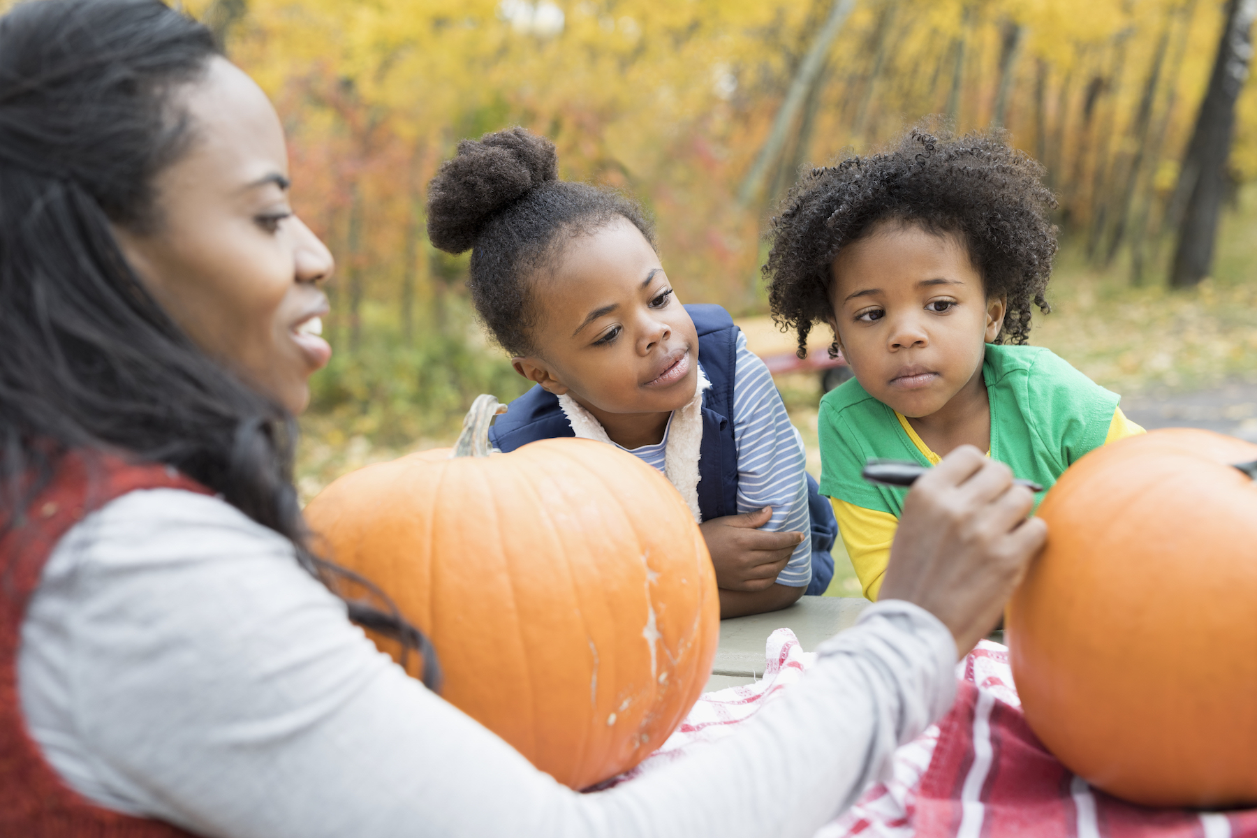 Mom and Kids Carving Pumpkins