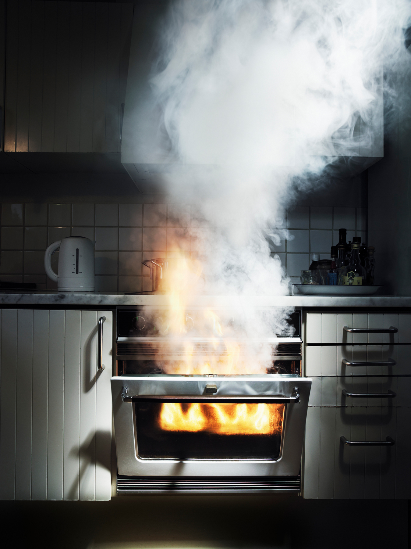 Fire coming out of oven - keep bedroom door closed home fire safety tip