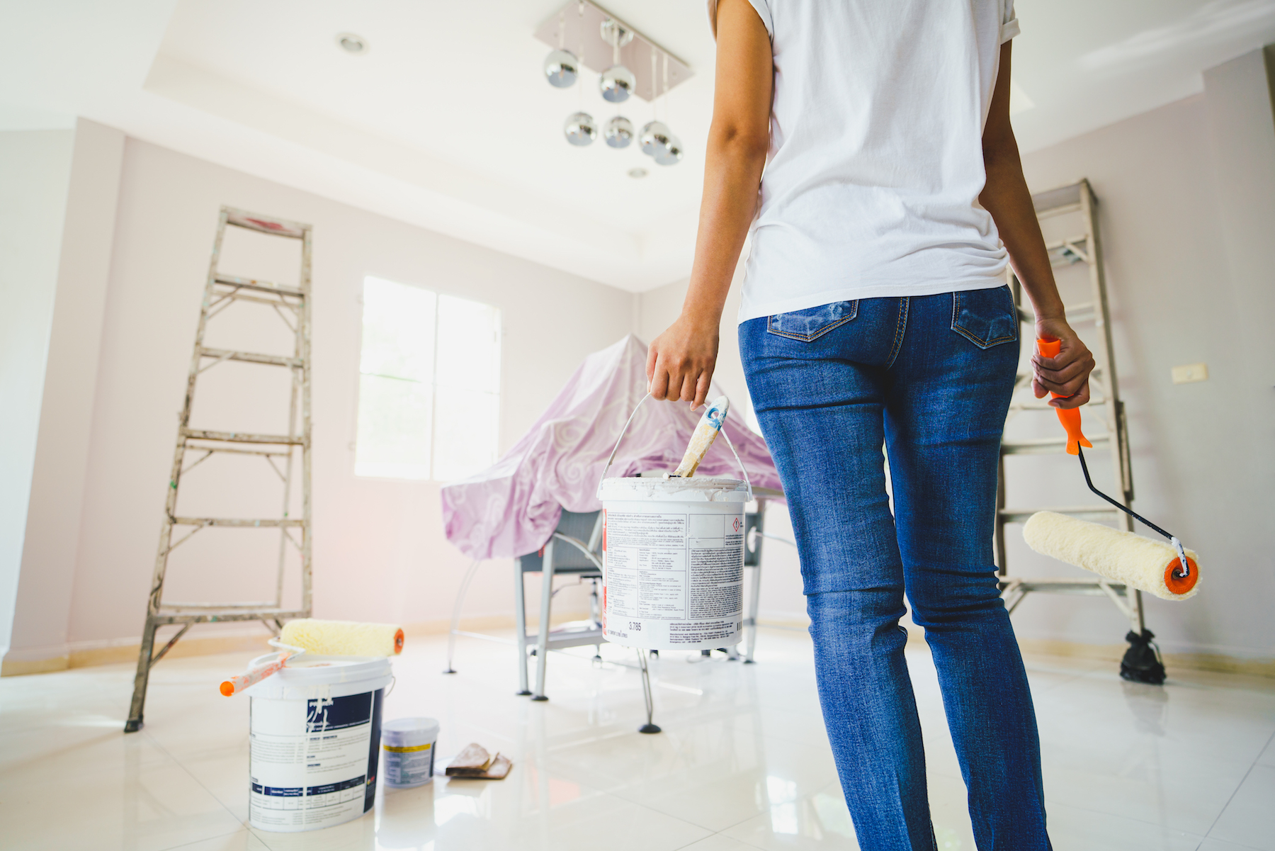 Women preparing to paint a room