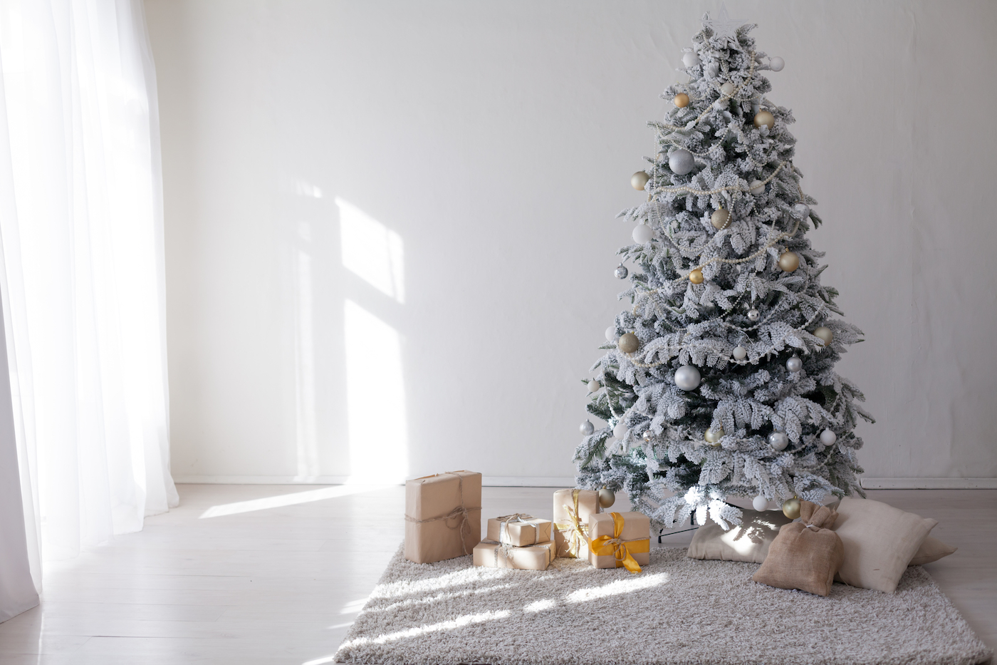 holiday presents under a christmas tree