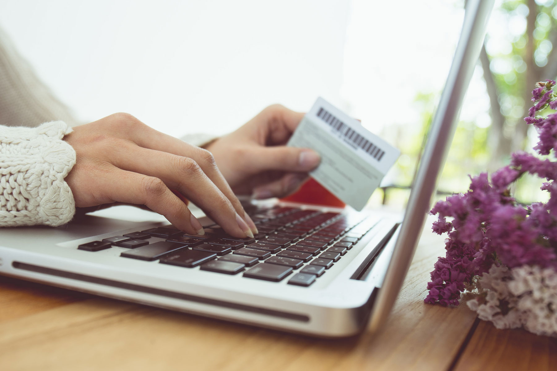 Woman shopping online using UncommonPerks from UncommonGoods