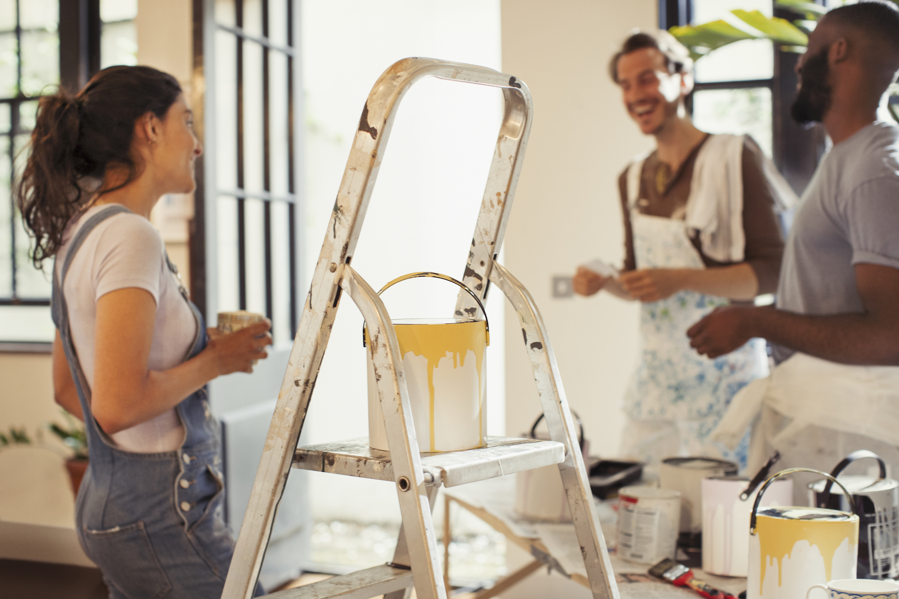 friends painting living room mustard yellow paint trend