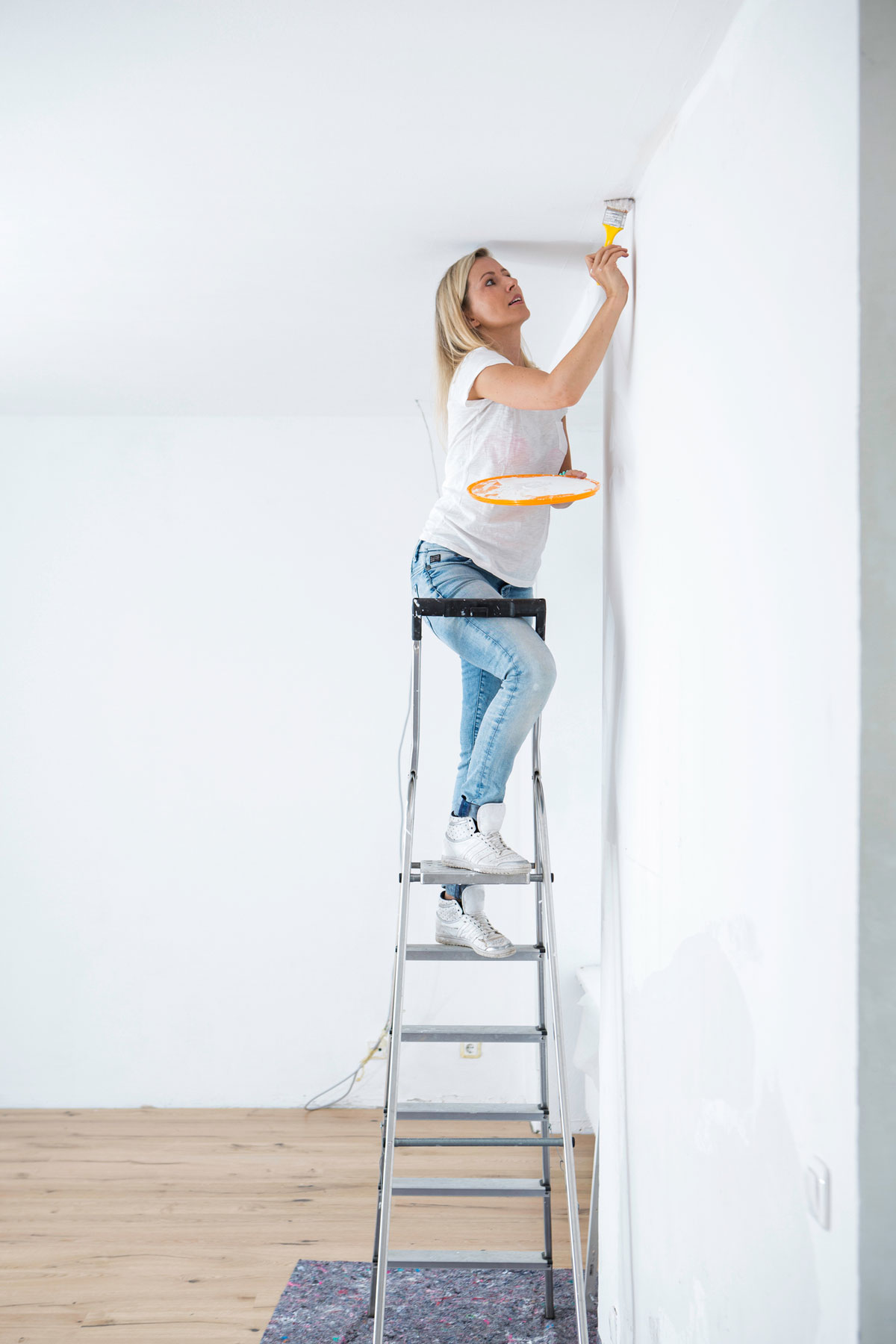 Ceiling paint color - woman painting ceiling