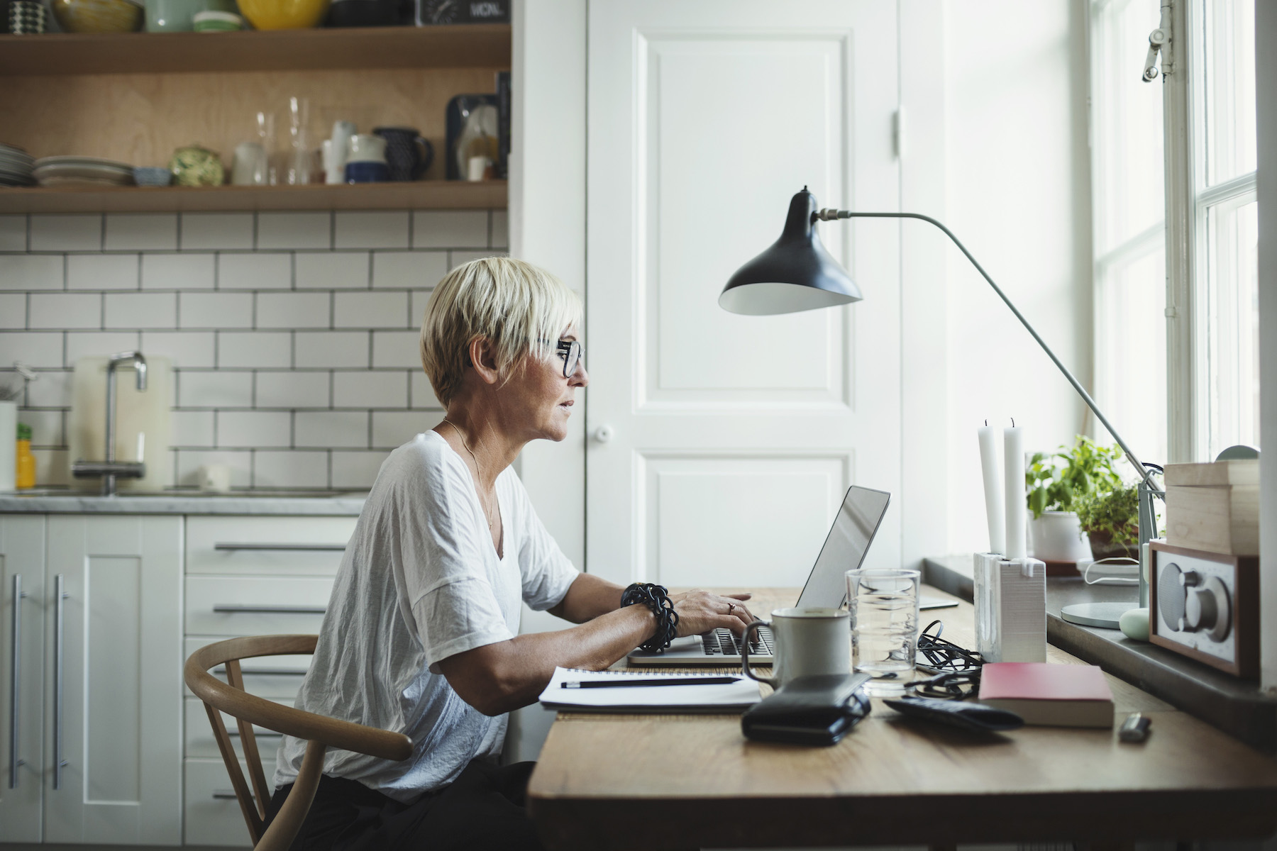 woman working at home office in kitchen