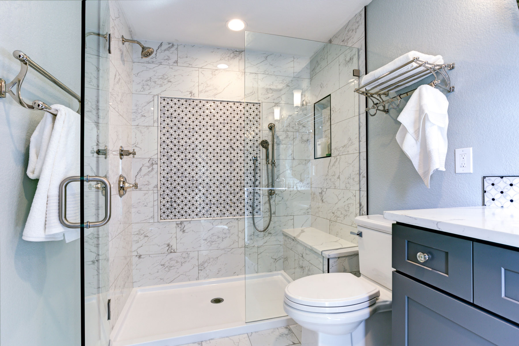 Bathroom Design Tricks for a Cleaner-Looking Bathroom - Marble Tiled Bathroom