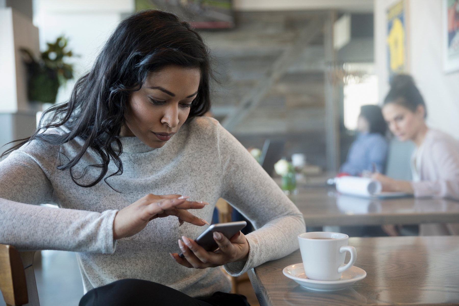 Unsend messages on Facebook Messenger - woman typing on phone