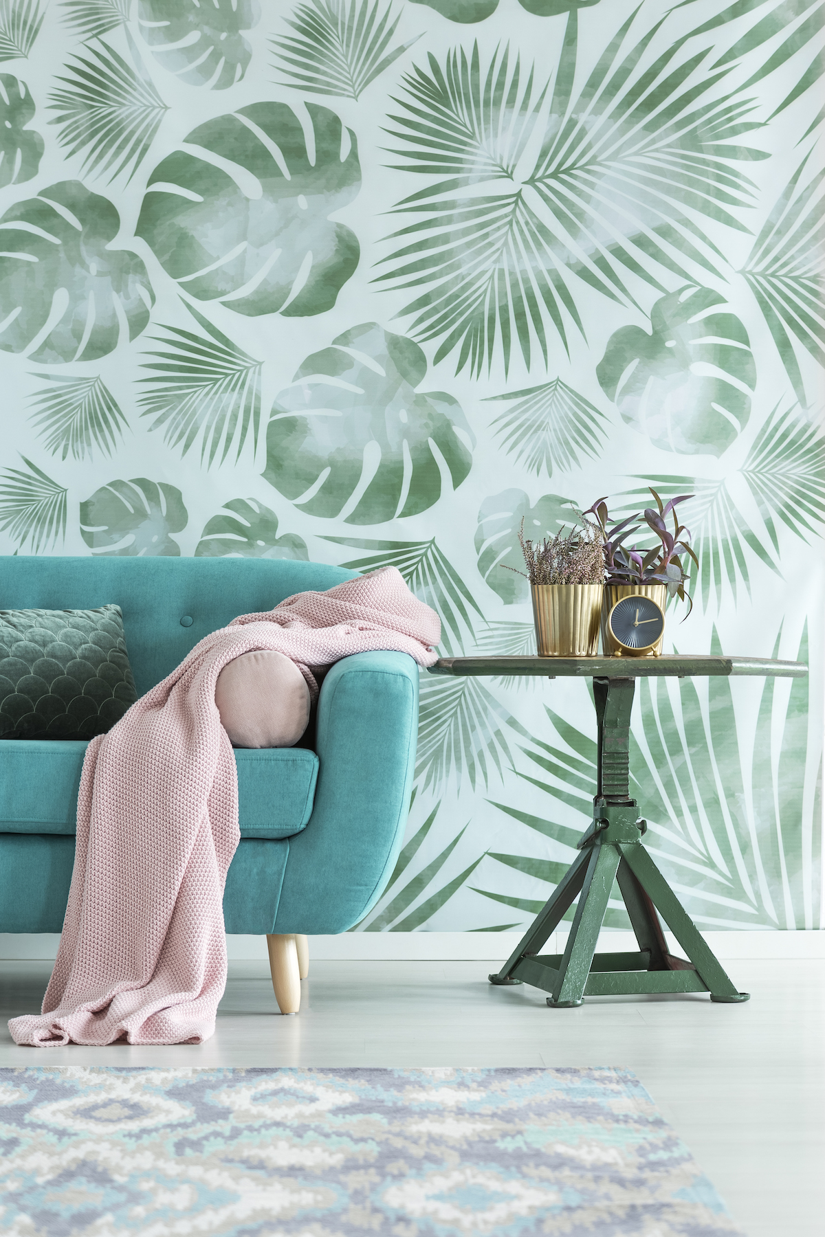 Best Paint Colors 2019, teal couch with leaf painted wall