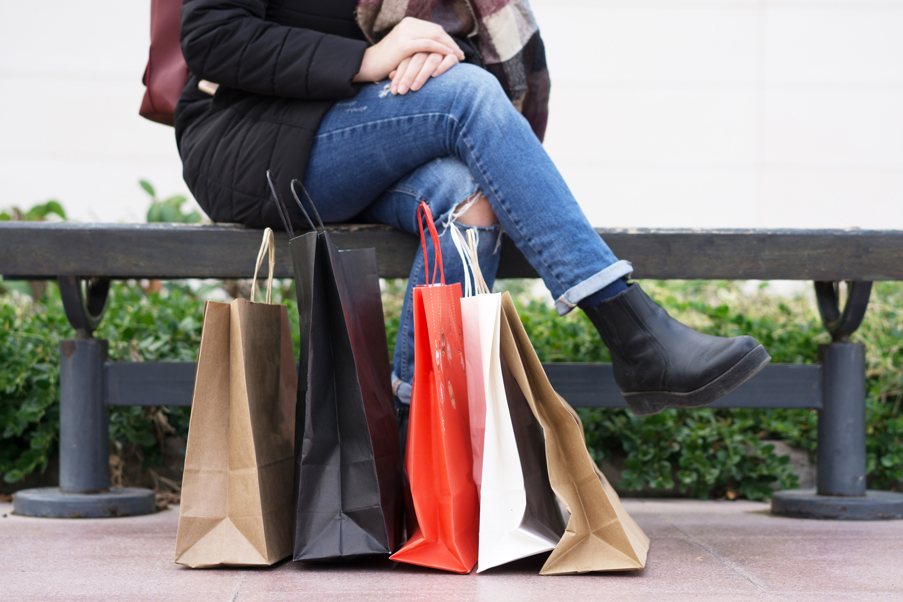 Outlet mall shopping secrets woman with shopping bags
