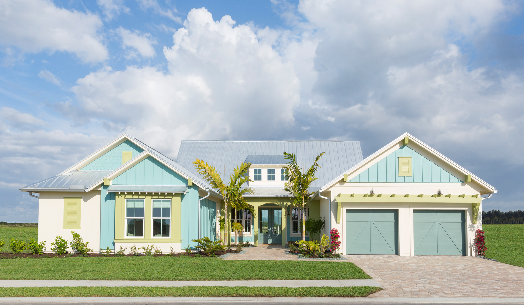 Board and batten exteriors - A colorful house with board and batten siding