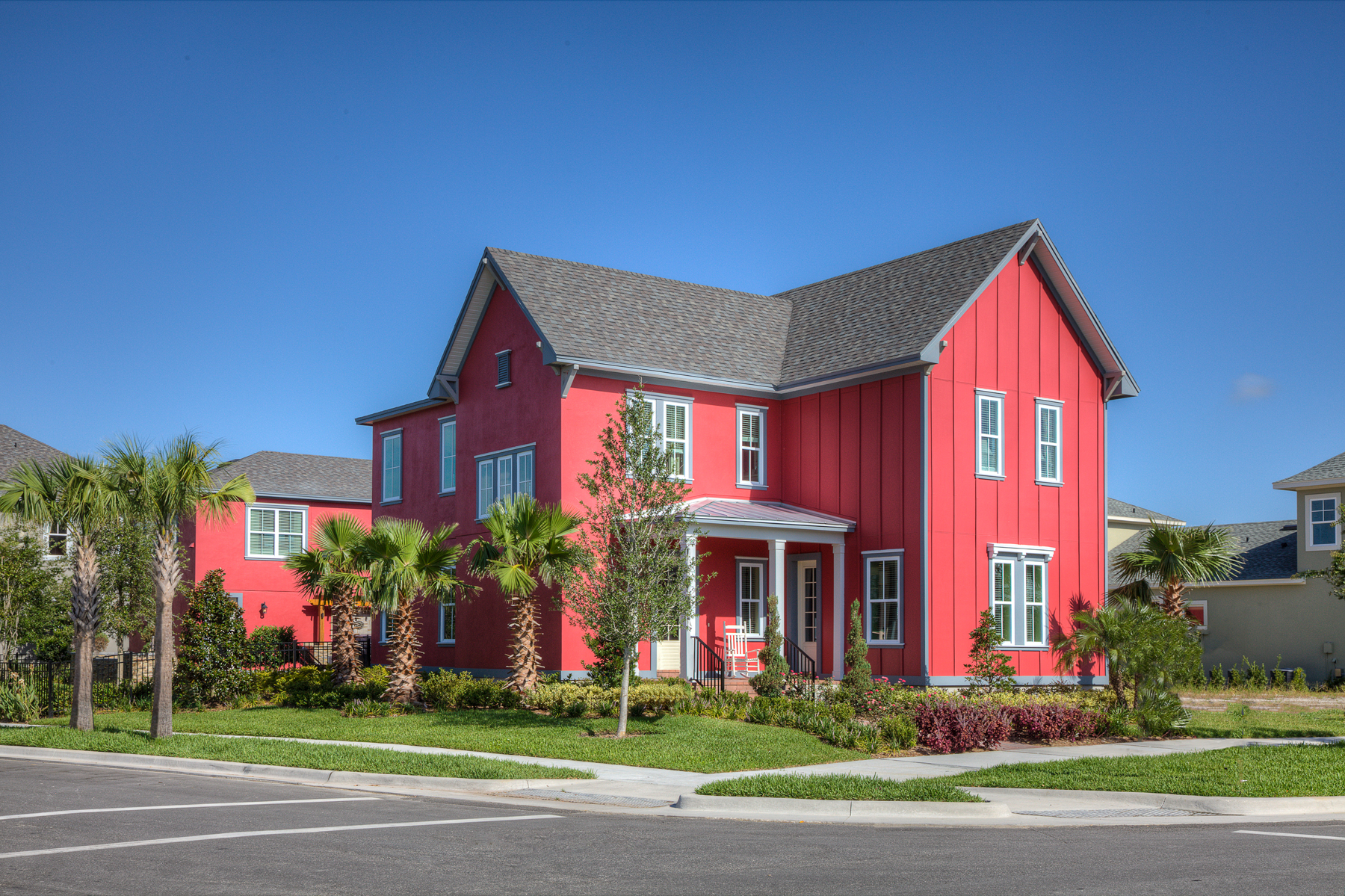 Board and batten exteriors - A red house with board and batten siding