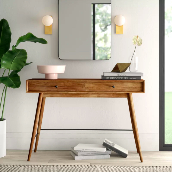 console table with vignettes, books and bowls