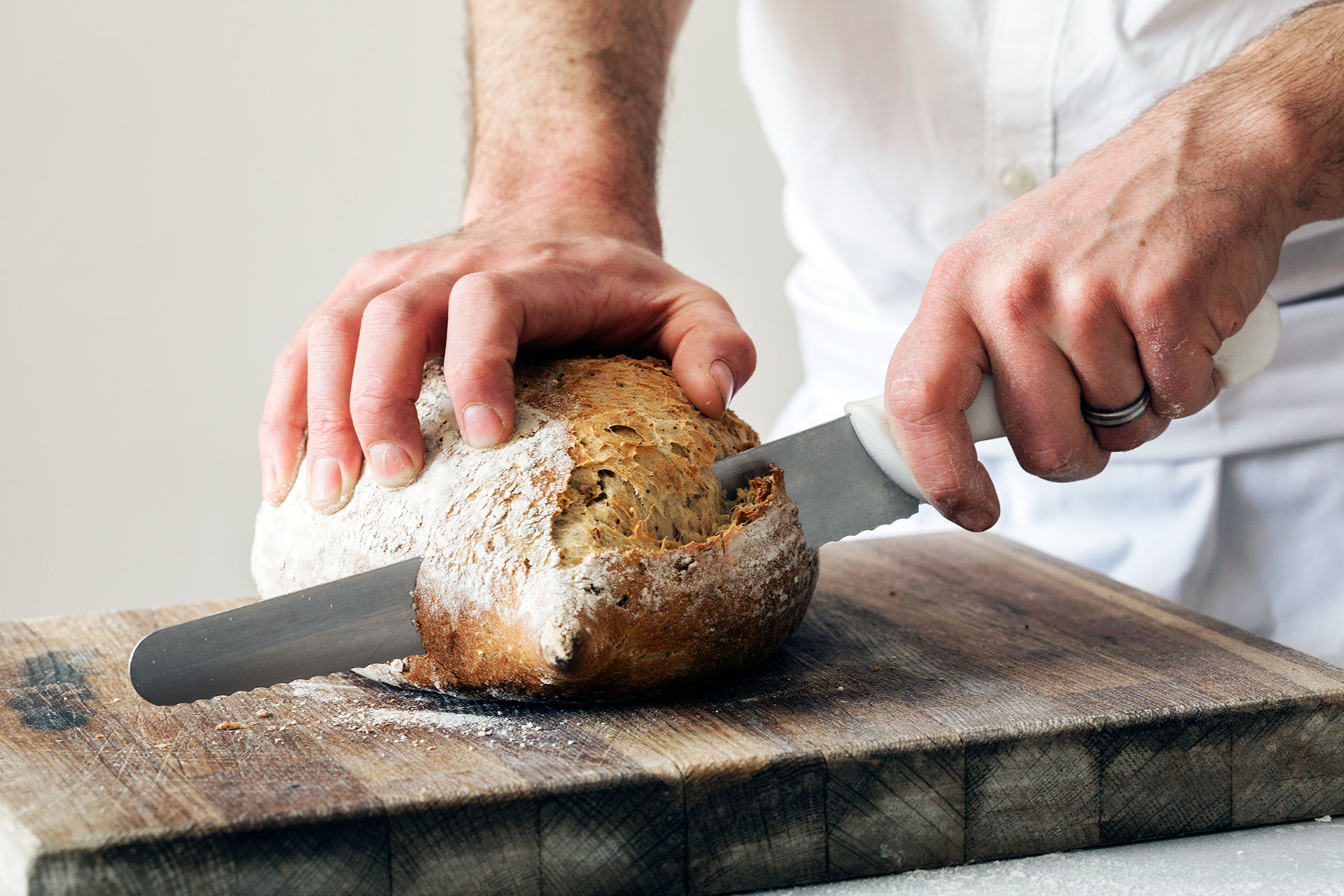 Slicing Bread on Cutting Board