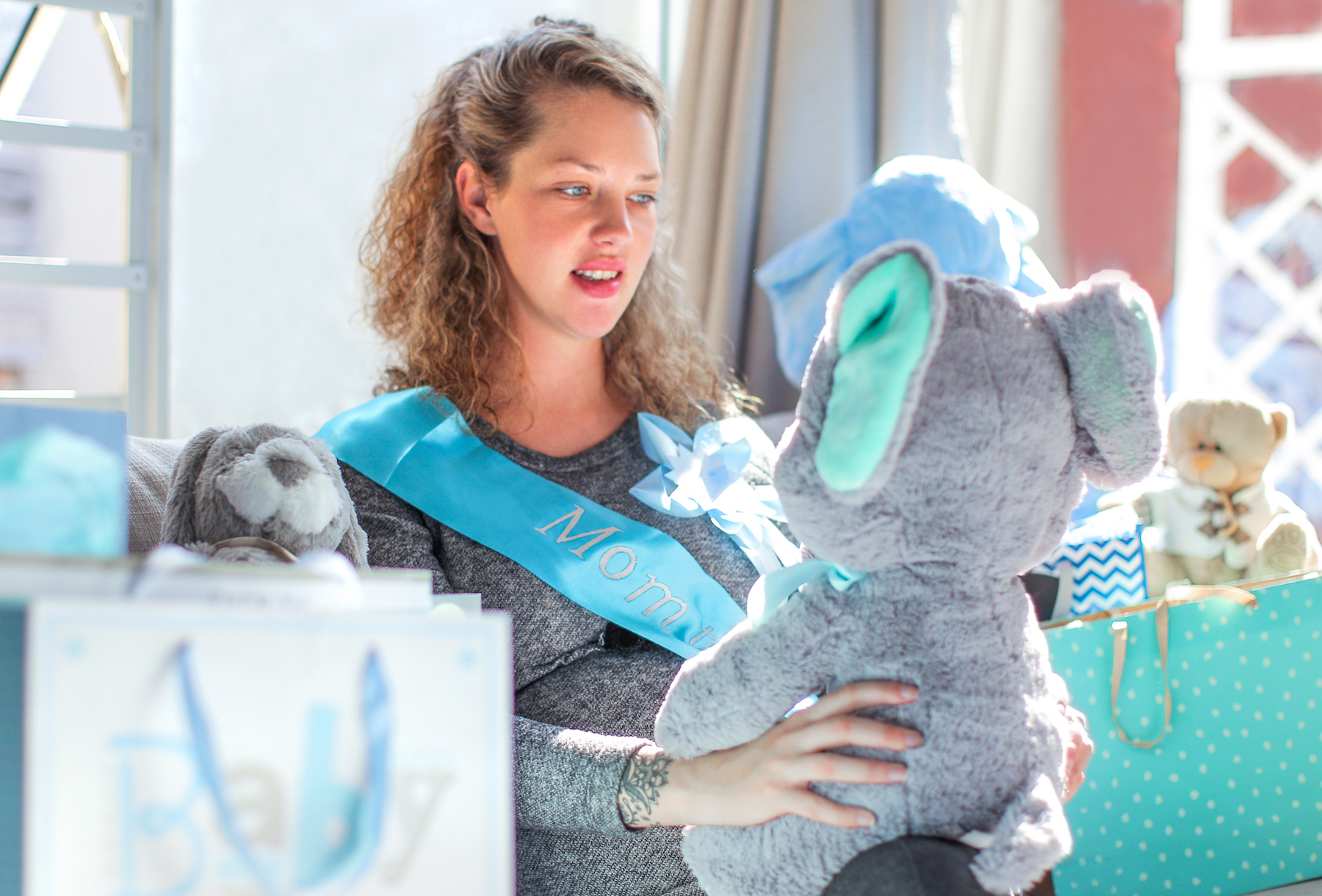 Woman with giant stuffed animal at baby shower