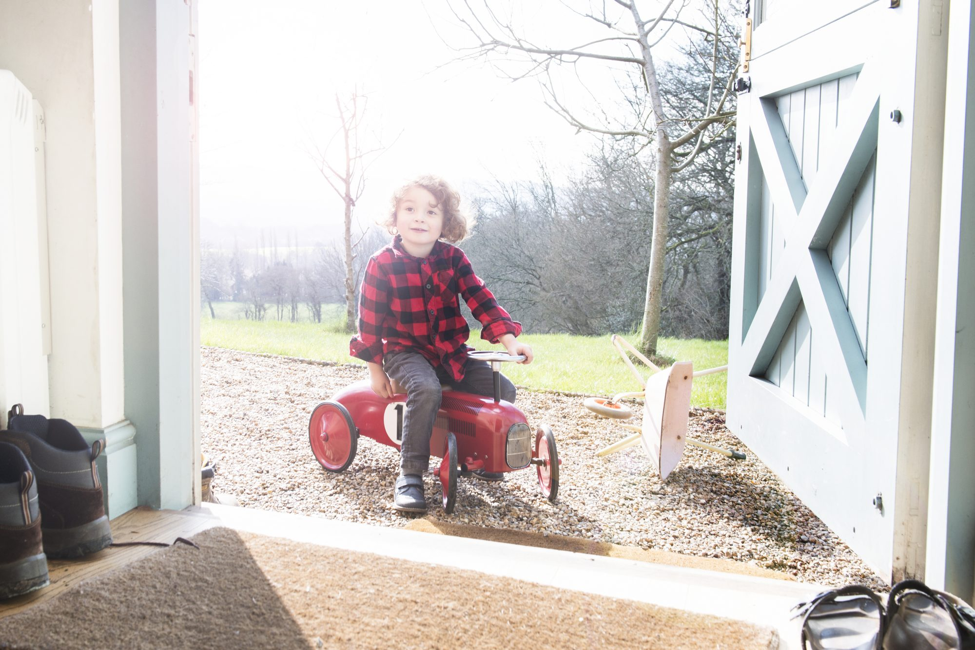 Dutch Door, Child Playing Outside in red checked shirt