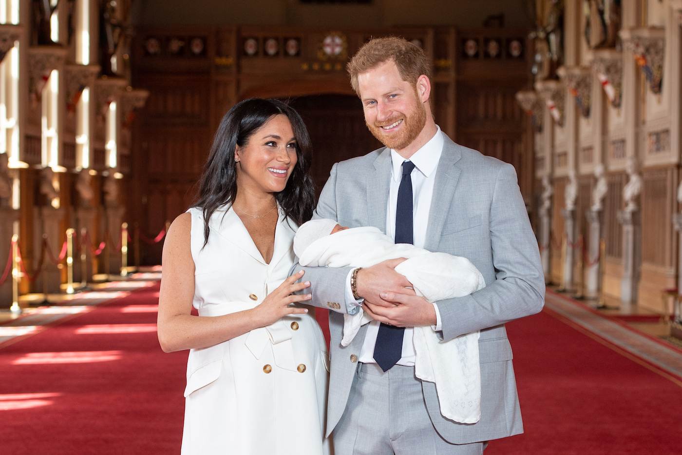 Meghan Markle and Prince Harry pose with newborn son
