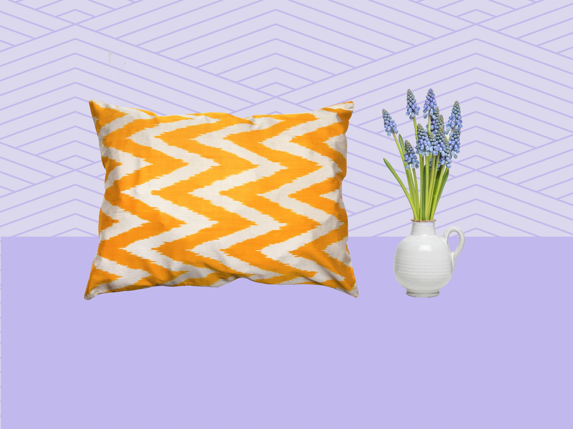 Styling Tricks for a Cleaner Looking Home, pillow and fresh flowers