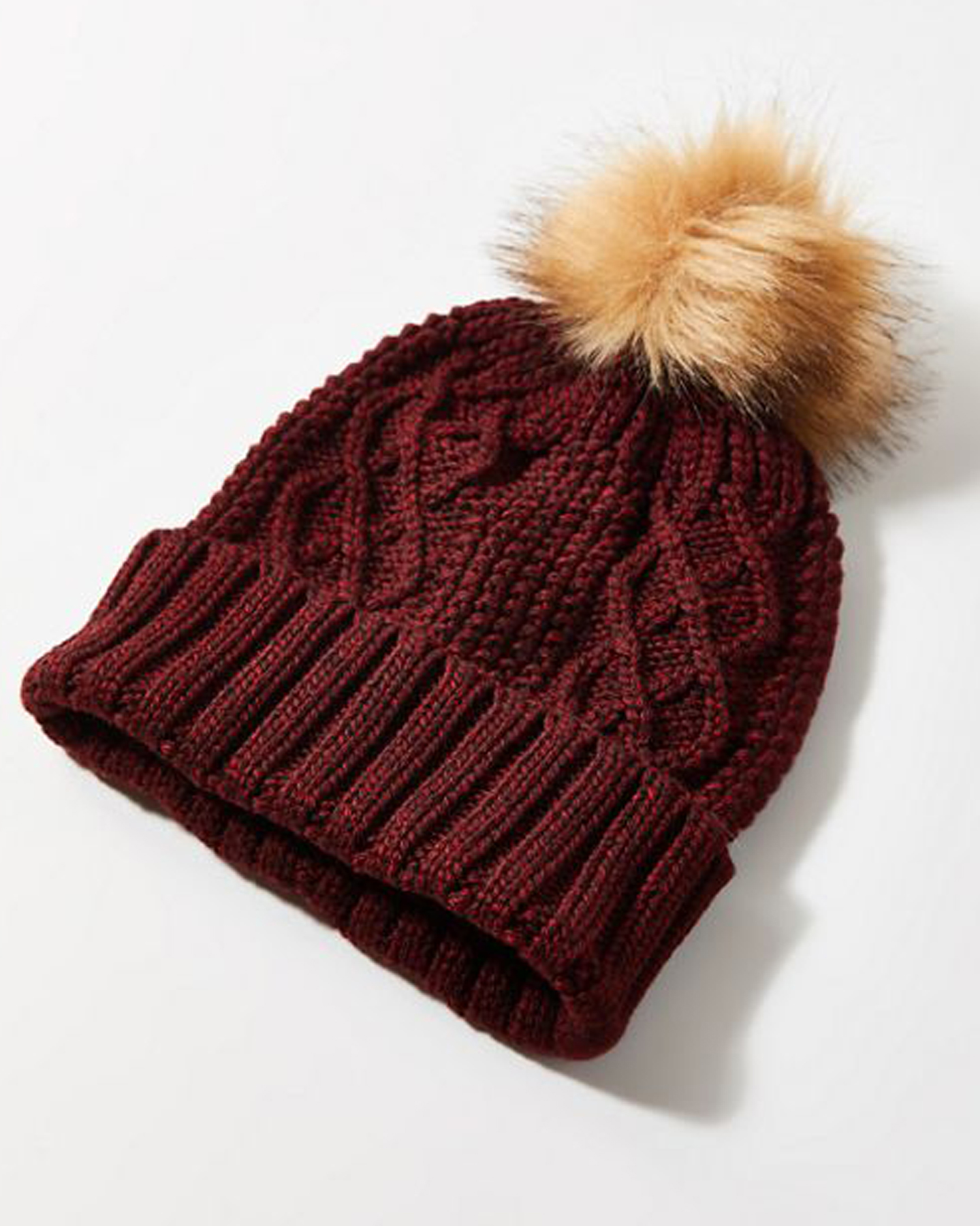 Cheap Christmas Gifts: Maroon cableknit pompom beanie from Urban Outfitters