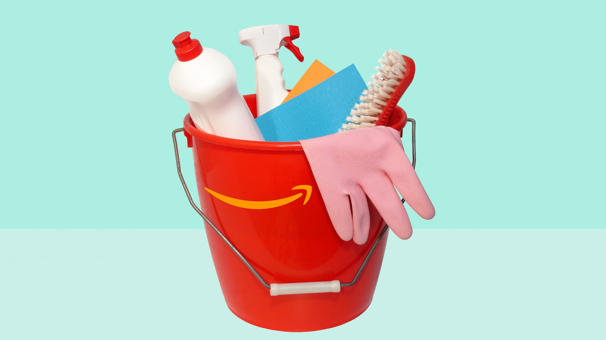 bucket of cleaning supplies on green background
