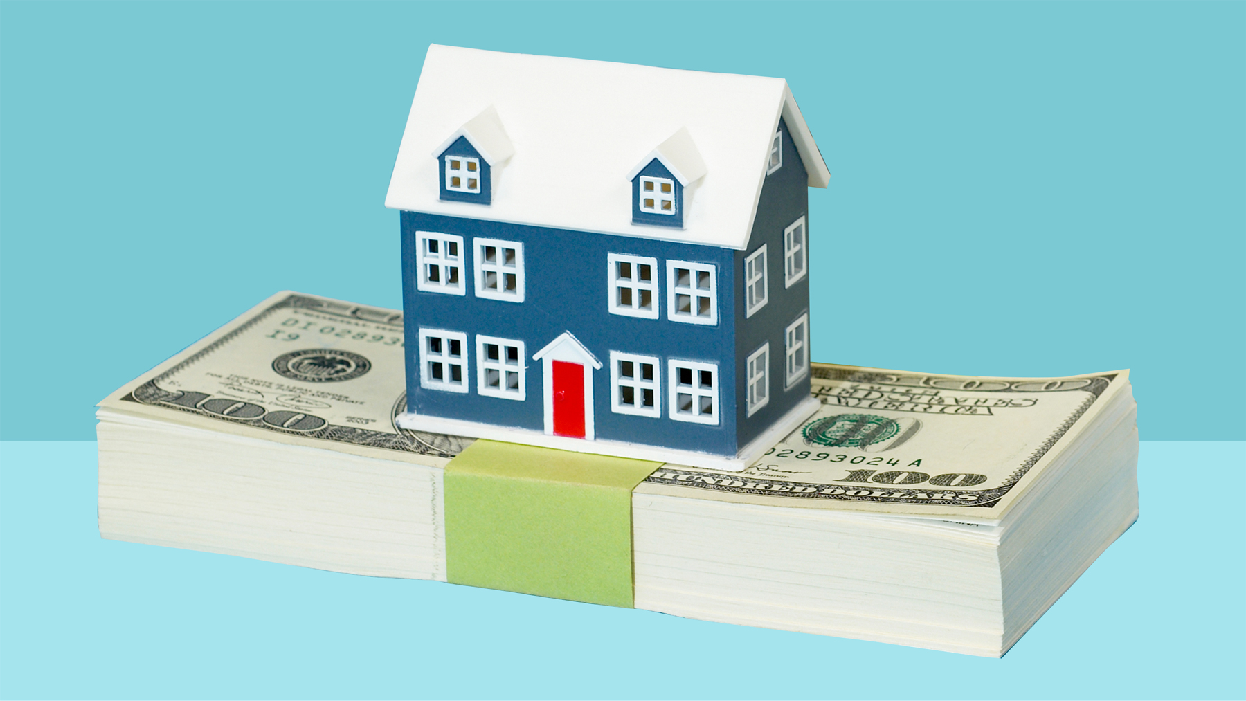illustration of a house on top of a stack of money: how to use your tax refund wisely