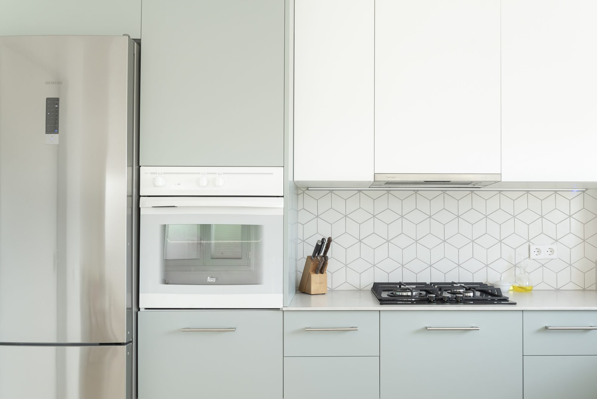 How to Clean Kitchen Cabinets, clean kitchen with light blue cabinets