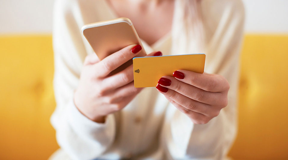woman using phone to shop online: How to shop online safely