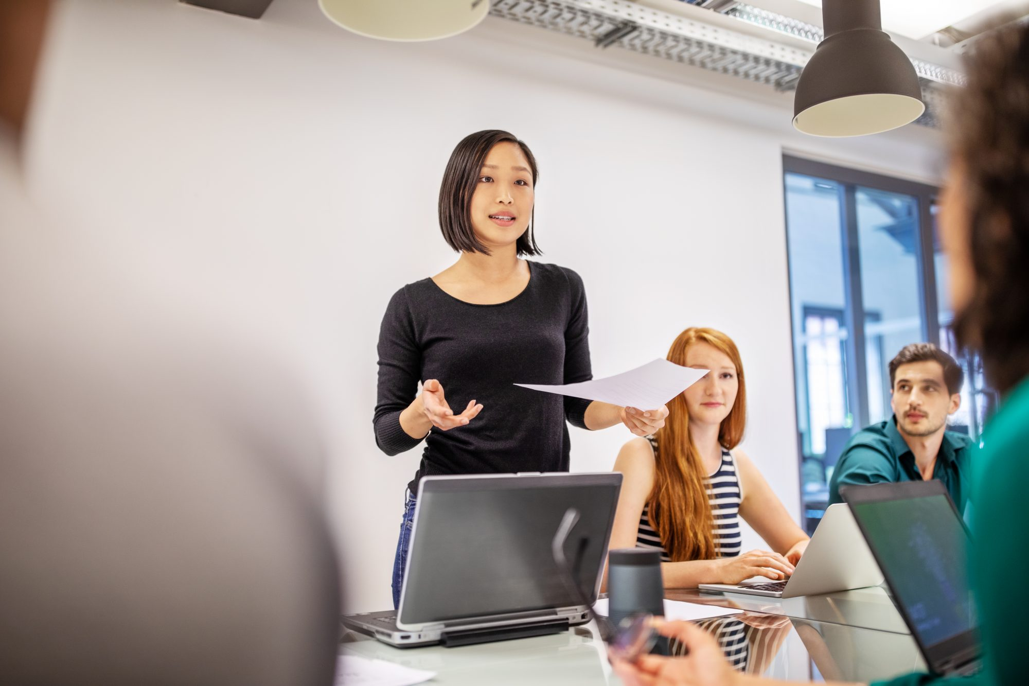 serious-at-work: woman presenting to a group