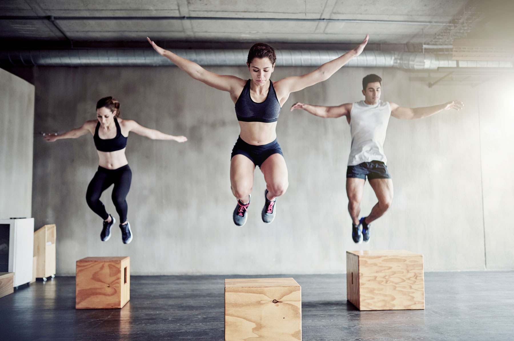 The toughest workouts on classpass, according to reviewers (people box-jumping)