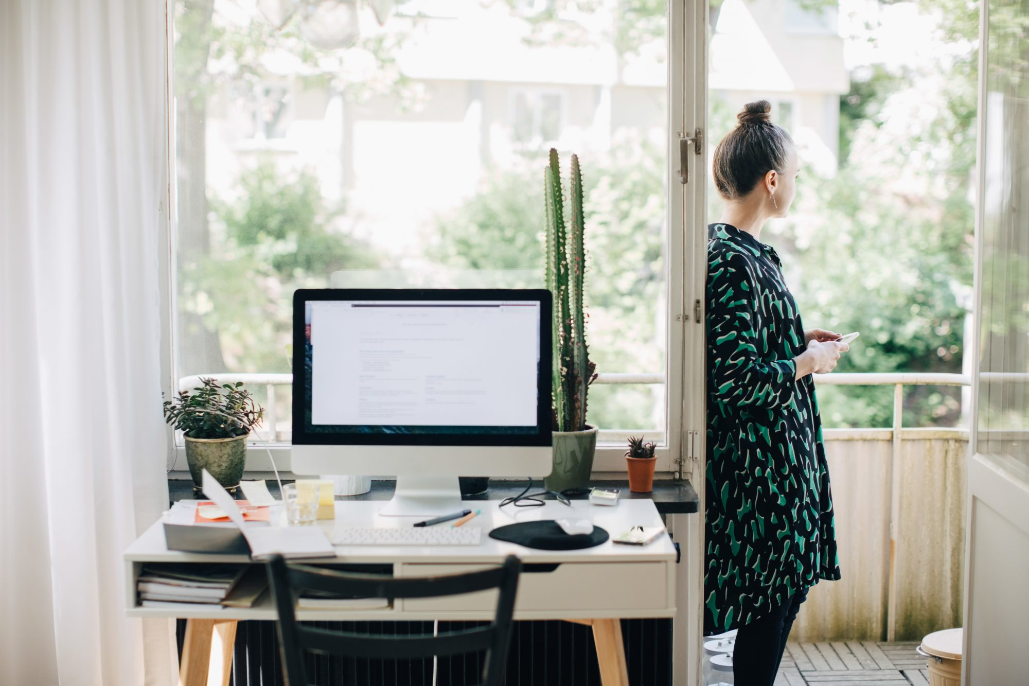 Tips for Creating a Makeshift Work-from-Home Space, woman working from home