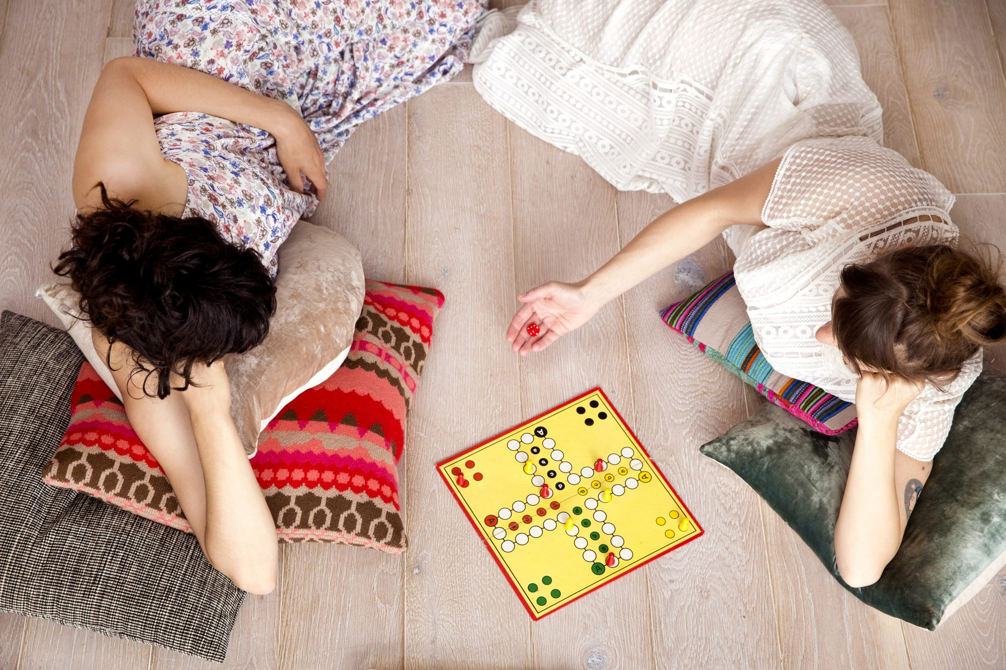 people playing a board game at home