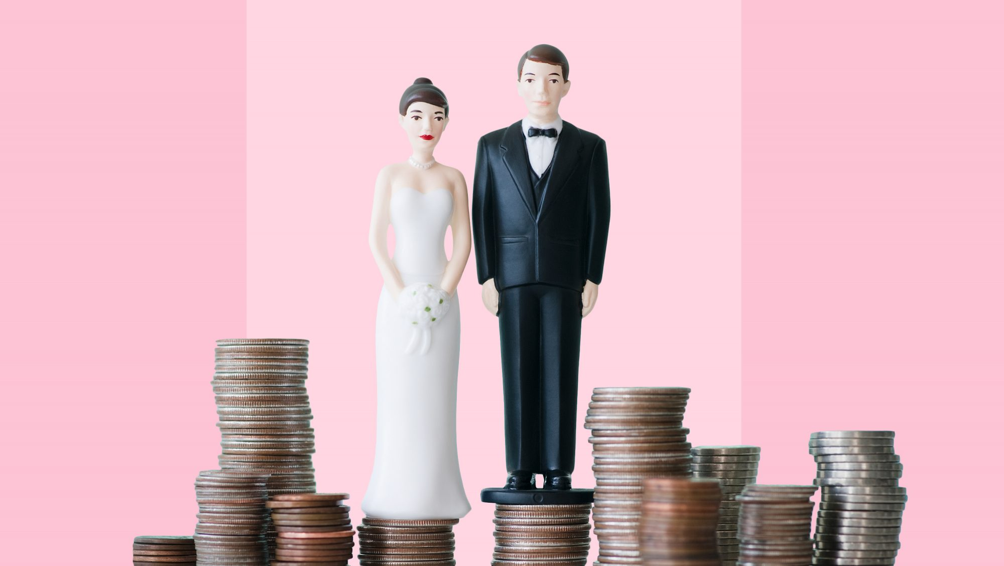 bride and groom wedding cake toppers standing on money: What Does Wedding Insurance Cover