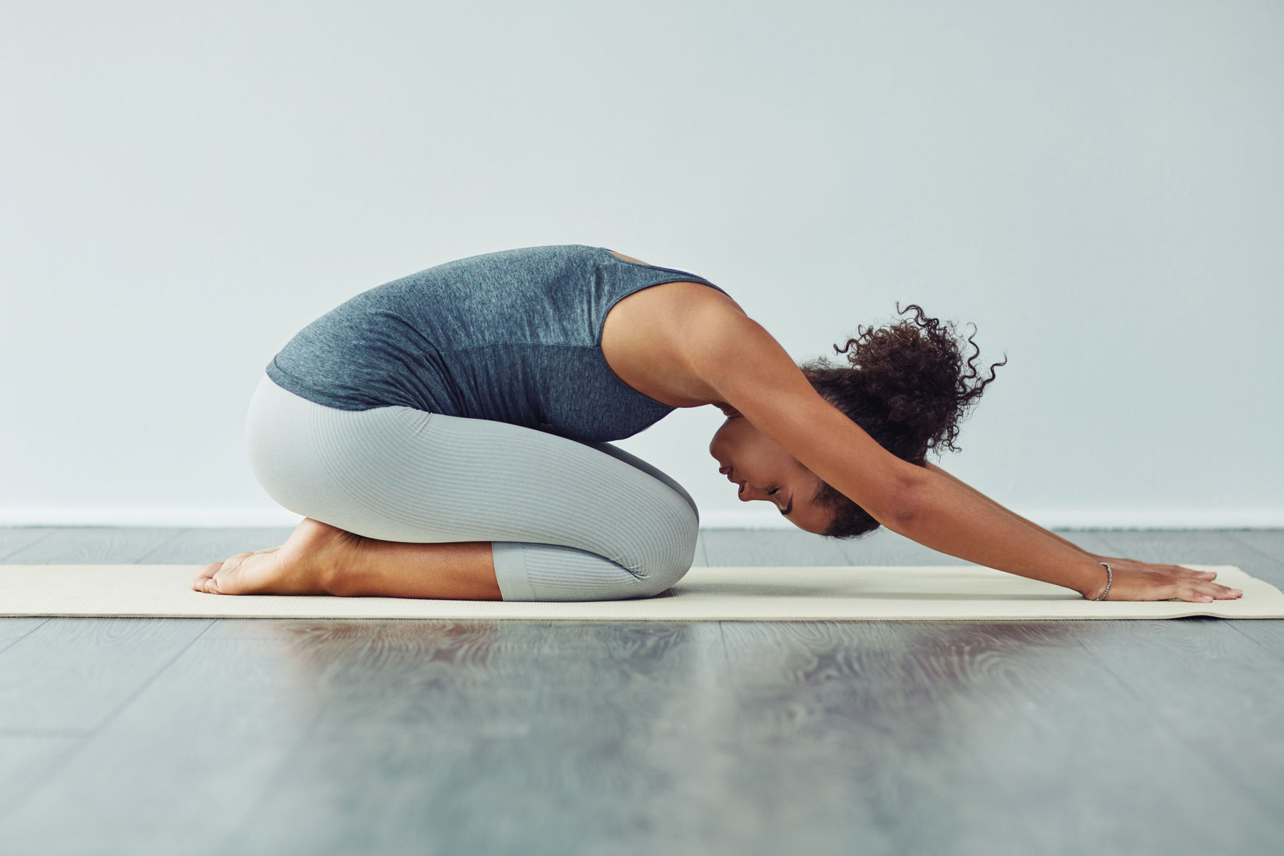 Best at-home workout videos: free streaming services, YouTube workout videos, and more (woman doing yoga)