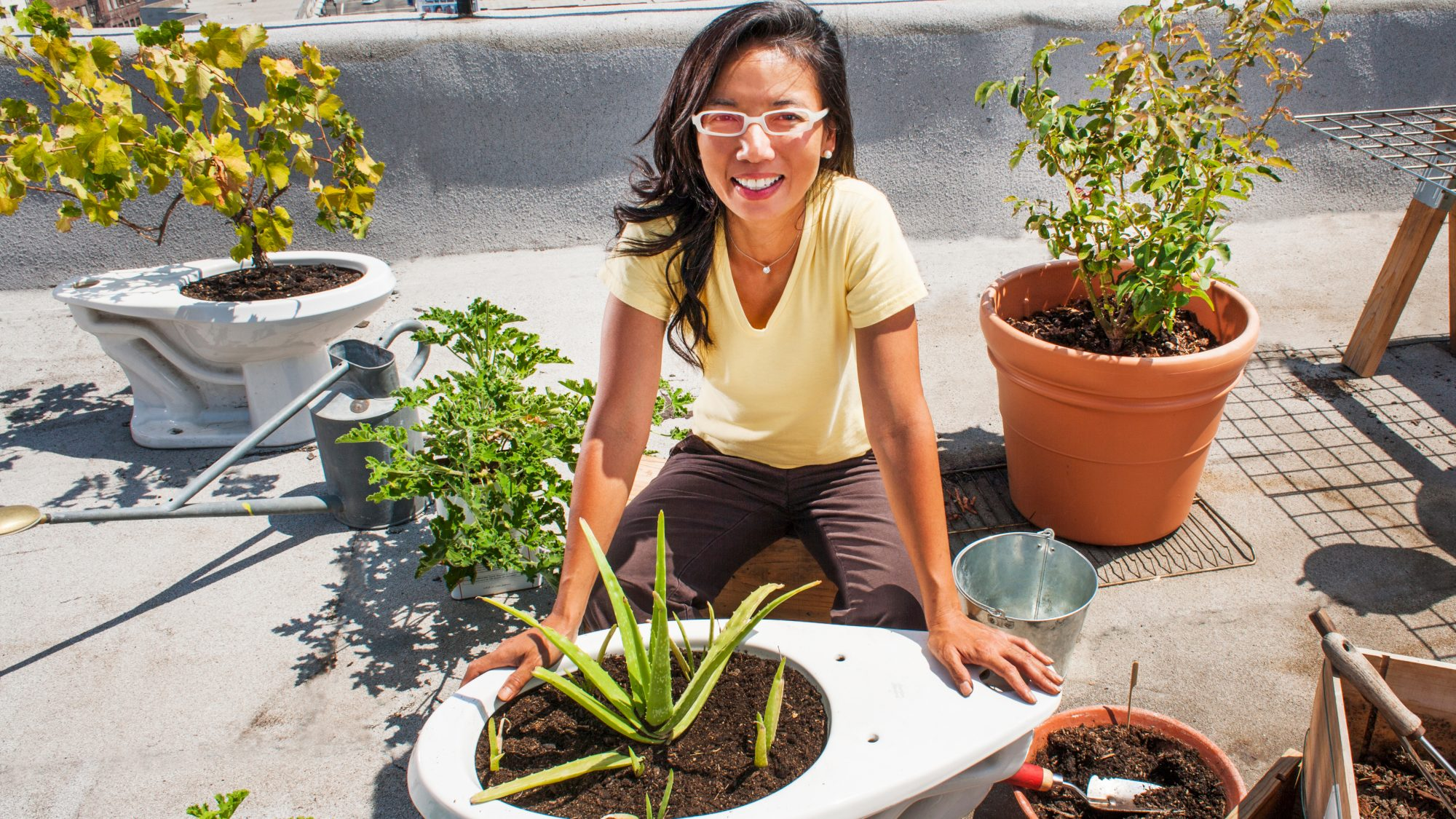 Woman working on container garden project outside