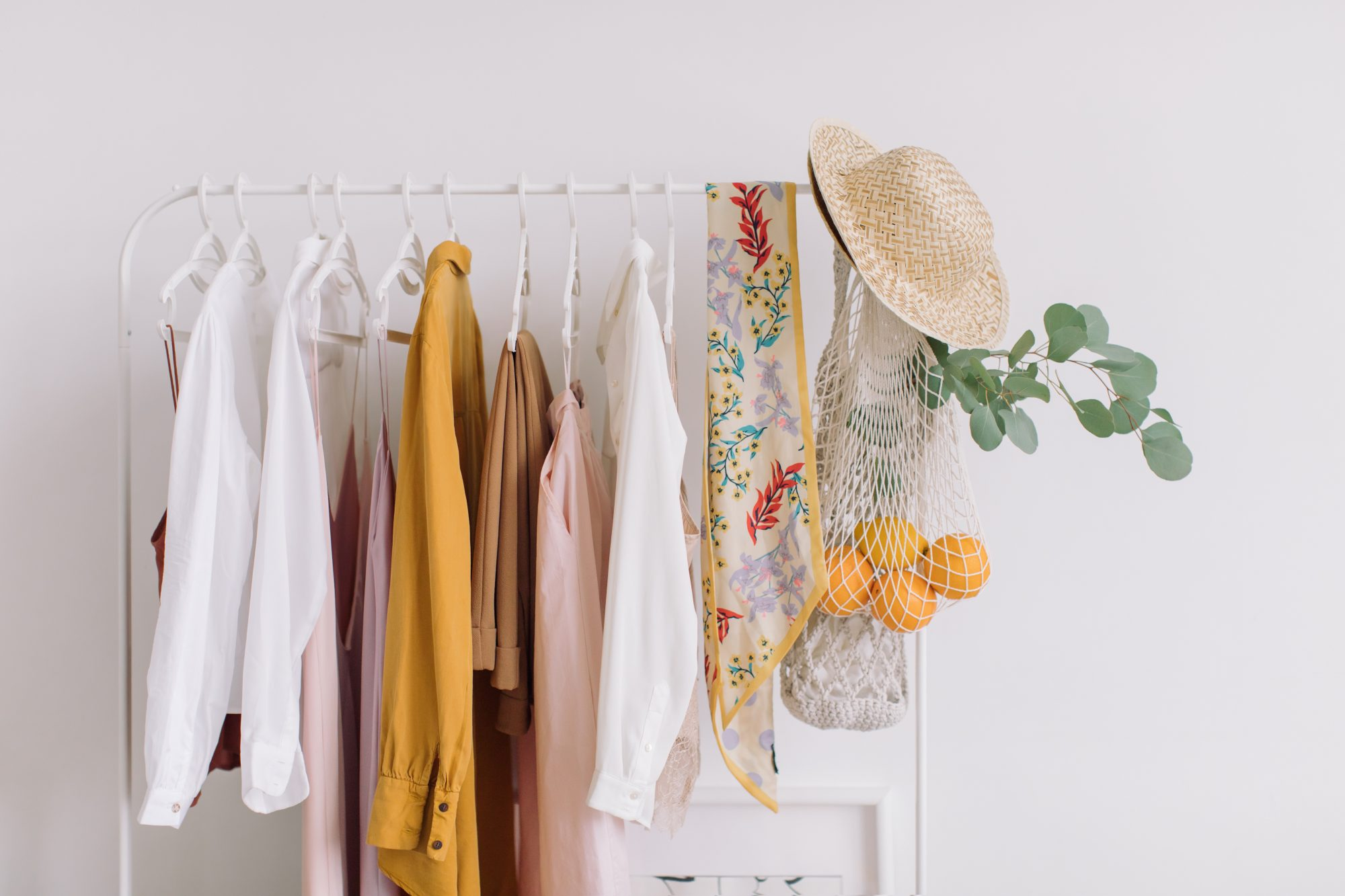 sustainable clothing brands hanging in a closet
