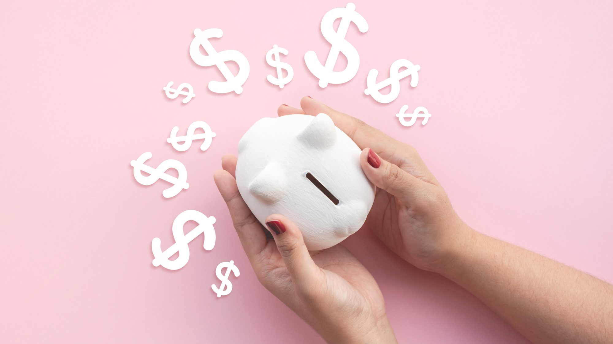 How to spend and save during coronavirus tout - piggy bank with dollar signs on pink background