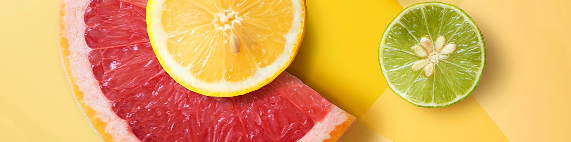 Flat lay assorted citrus fruits on graphical design background. Decorative design background.